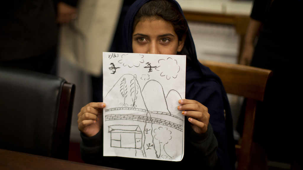 Nabila Rehman, 9, shows a drawing of a drone attack in court (picture: Reuters)