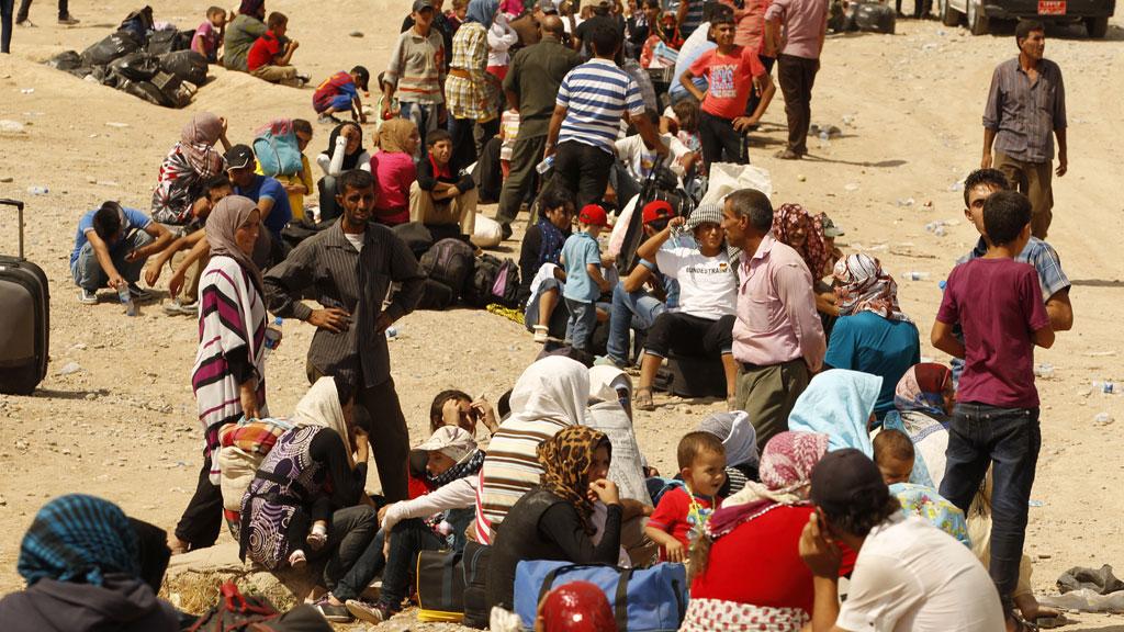 Syrian refugees (R)