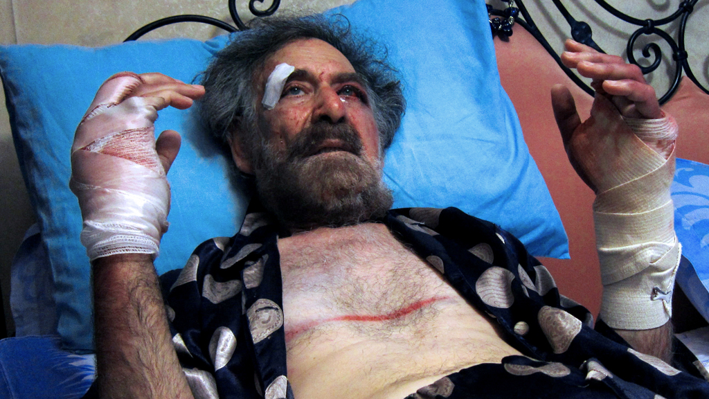 Syrian cartoonist Ali Ferzat in hospital after being beaten up in 2011 (picture: Getty)