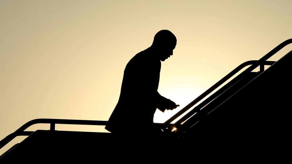 Barack Obama in silhouette boarding a plane. (Getty)