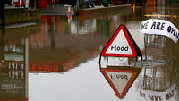 Picture: a flood sign stands beside a petrol station close to the River Severn at Upton upon Severn (G)