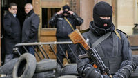Ukraine special forces outside administration building in Kharkiv (picture: Reuters)