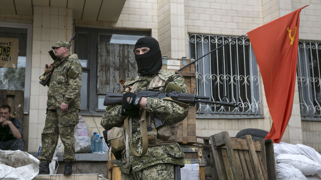 Pro-Russian armed men stand guard outside a regional government building seized by them in Kramatorsk, eastern Ukraine (Reuters)