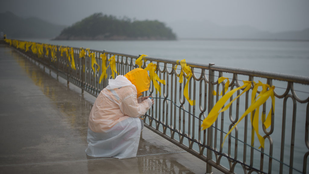 A mourner at Jindo seafront (picture: Getty)