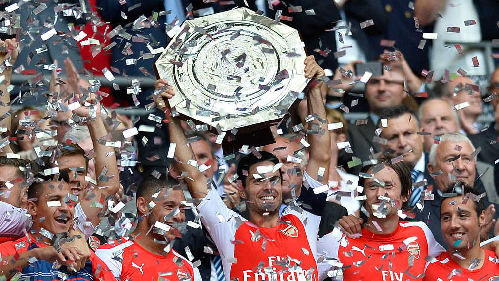 Arsenal players celebrate winning the 2014 Community Shield (Getty)