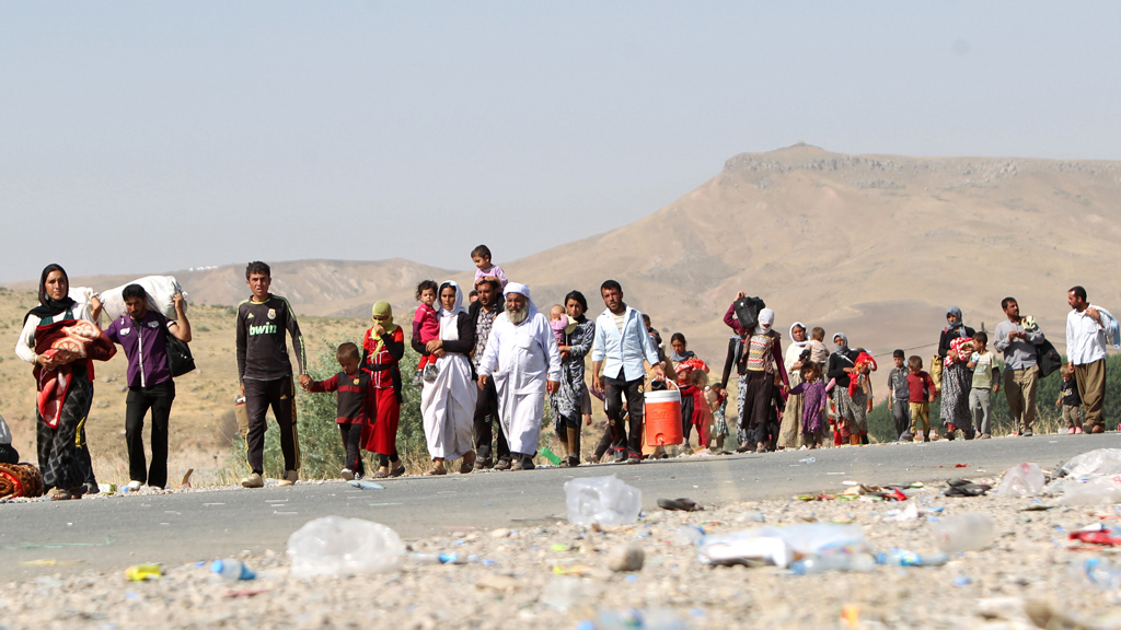 Yazidi people fleeing Mount Sinjar