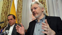 Julian Assange gives surprise press conference at the Ecuadorian embassy (R)