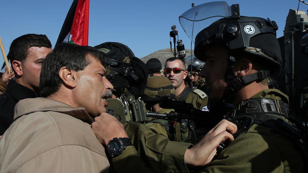 Ziad Abu Ein argues with Israeli troops (Getty)
