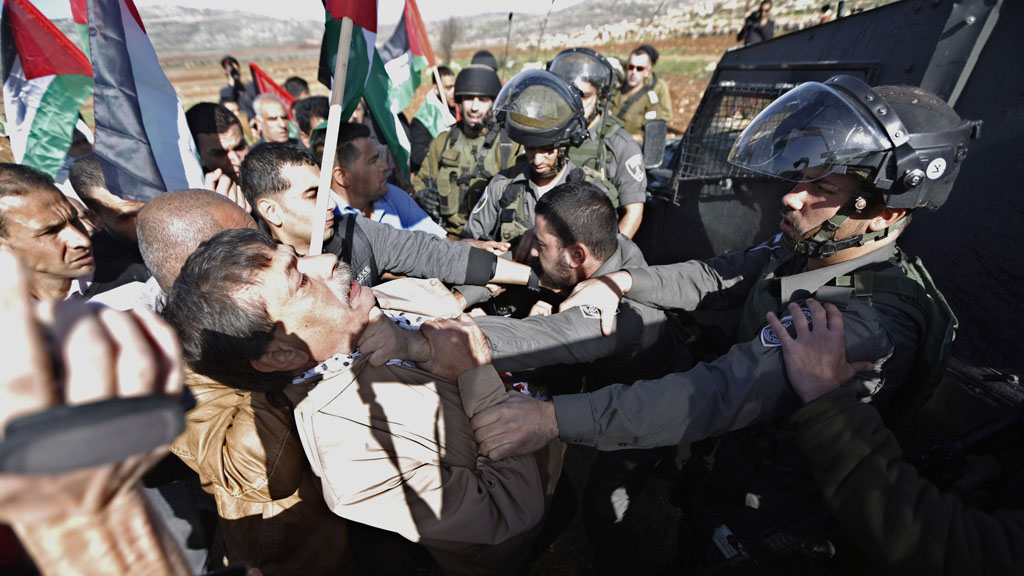 Ziad Abu Ein scuffles with Israeli troops shortly before his death (Reuters)