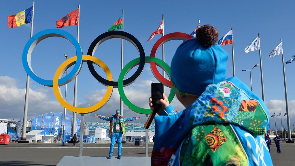 Sochi volunteers in rainbow-coloured uniforms. (Reuters)