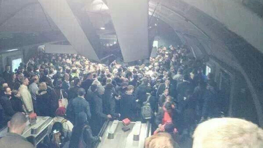 A crowd of passengers at Waterloo station