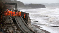 Railway workers inspect the main Exeter to Plymouth railway line that has been closed due to parts of it being washed away (G)