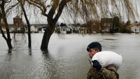 he Gurkha regiment help place sandbags outside residential properties along the River Thames