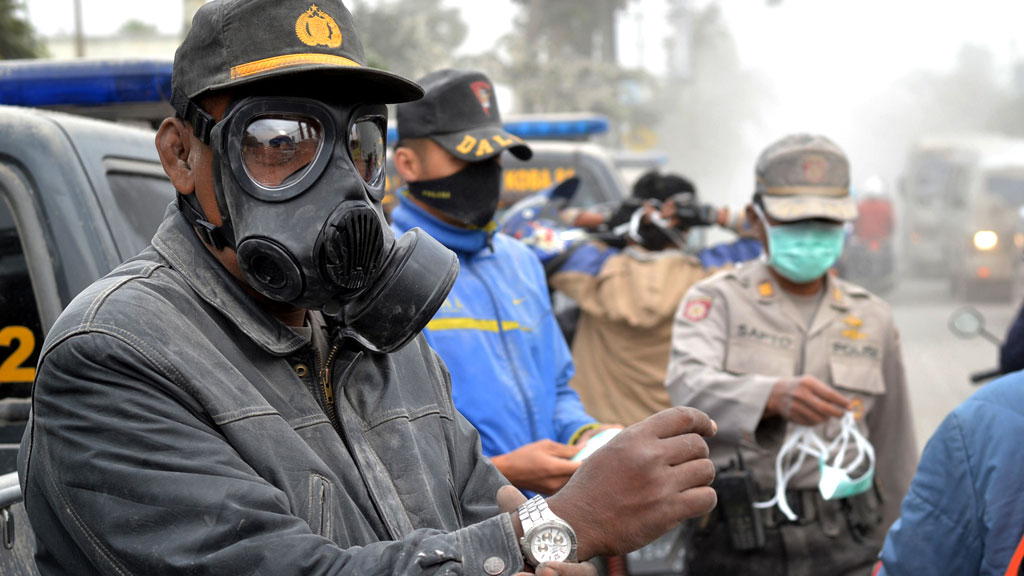 Indonesian police distribute face masks to residents on the streets of Malang, East Java (G)