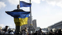Ukraine: protester holds up flag in Kiev (picture: Getty)