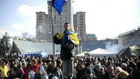 Ukraine's new government faces the people at Kiev's independence square (R)