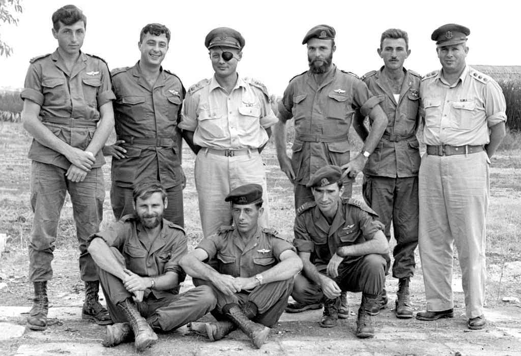 Sharon with Moshe Dayan and other Israeli military leaders in 1955