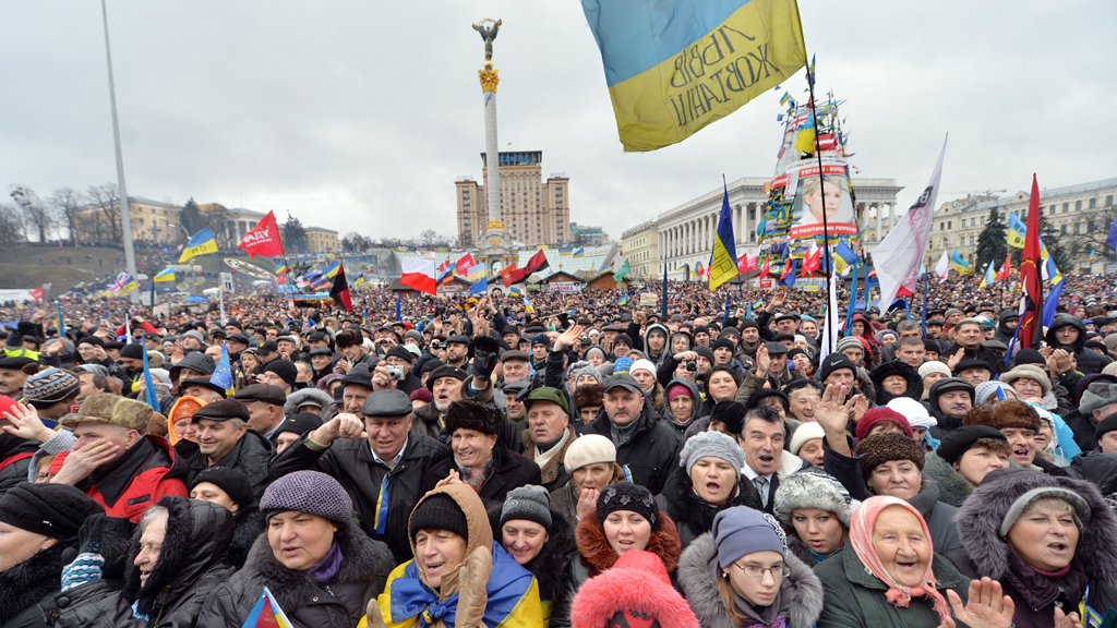 Protesters shout slogans during mass rally of the pro-Western Ukrainian opposition on Independence Square in Kiev (Getty)