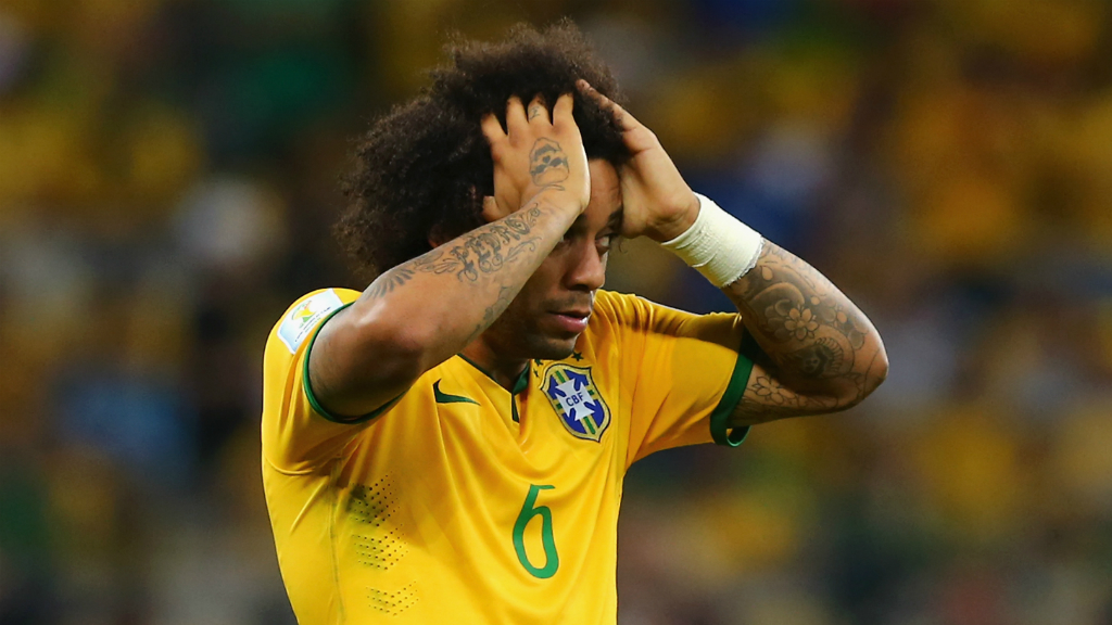 Brazil's Marcelo fights back the tears as the German's smash home their sixth goal. (Getty)