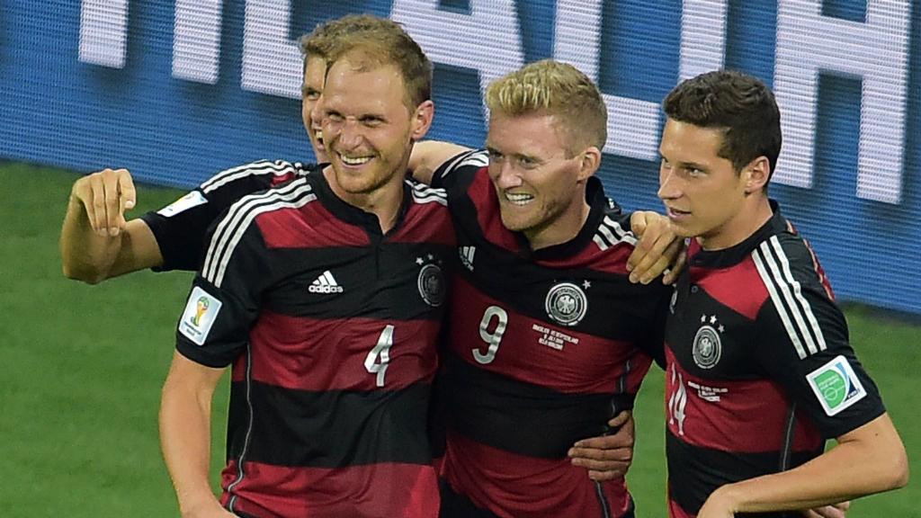 Germany forward Andre Schuerrle celebrates with Germany's defender Benedikt Hoewedes and Germany's midfielder Julian Draxler. (Getty)