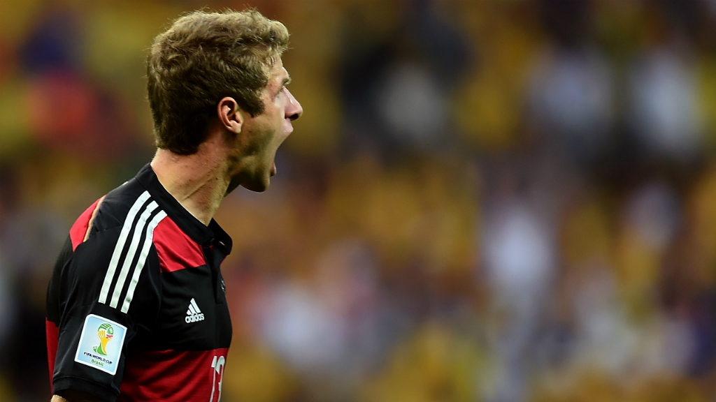 Germany's forward Thomas Mueller celebrates after scoring during the semi-final football match between Brazil and Germany