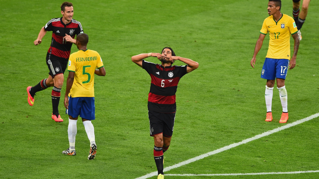Sam's town: Germany's Sami Khedira celebrates with teammates after scoring Germany's fifth goal. (Getty)