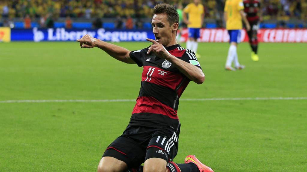 Miroslav Klose celebrates scoring against Brazil.