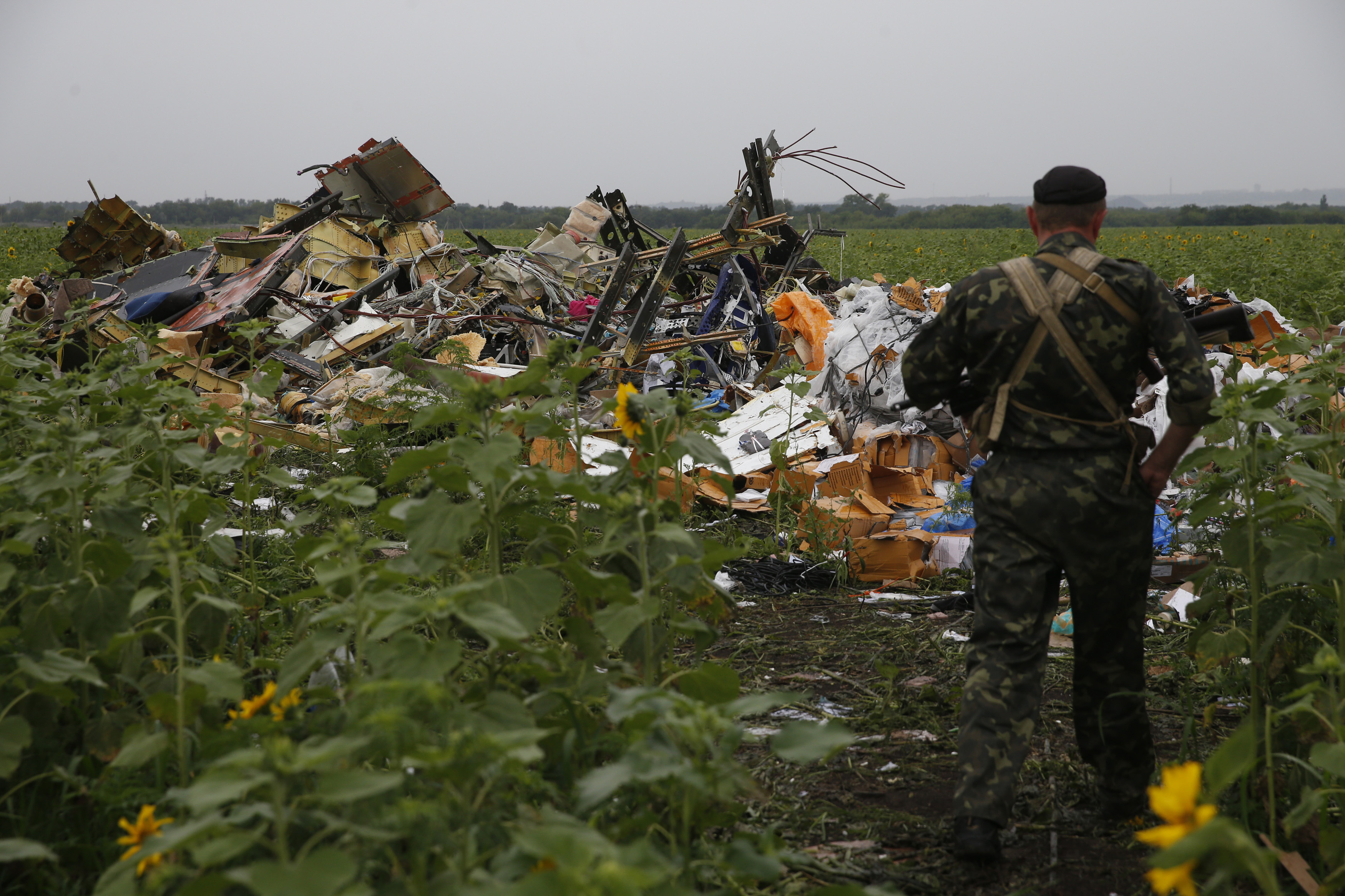 Pro-Russian separatist at MH17 crash site (Reuters)