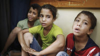 Children escape from Beit Hanoun school strike (Reuters)