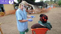 A nurse examines a patient the in-take area at a centre for victims of the Ebola virus in Gu�ck�dou, Guinea (credit: Getty Images)