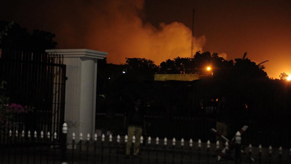 Smoke rises from Jinnah International Airport after an assault by gunmen (Getty)