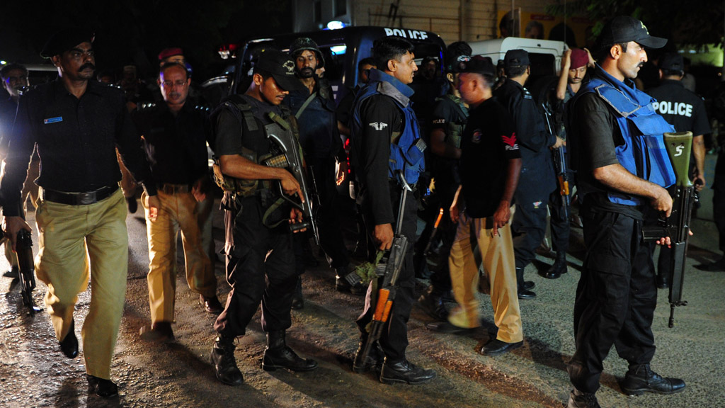 Pakistani security personnel gather outside the Jinnah International Airport after the assault in Karachi (Getty)