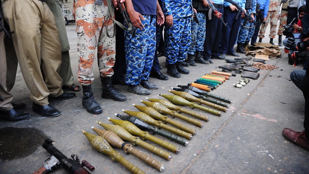 Pakistani policemen show seized weapons from the militants (Getty)