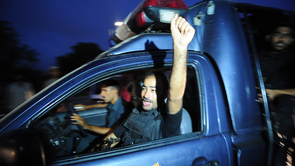 A Pakistani police commando shout slogans on his return from the operation against militants (Getty)