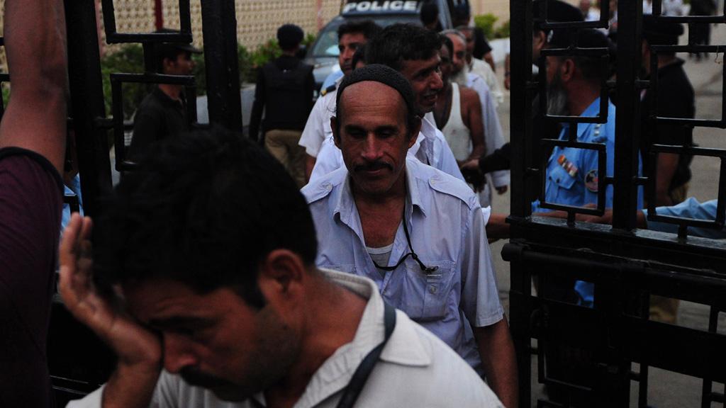 Pakistani airport employees leave the Jinnah International (Getty)