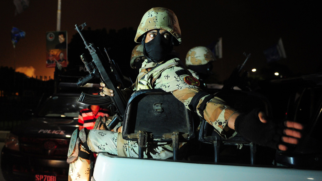 Pakistani troops arrives to take position at the Karachi airport terminal after the militants' assault in Karachi late on Sunday (Getty)