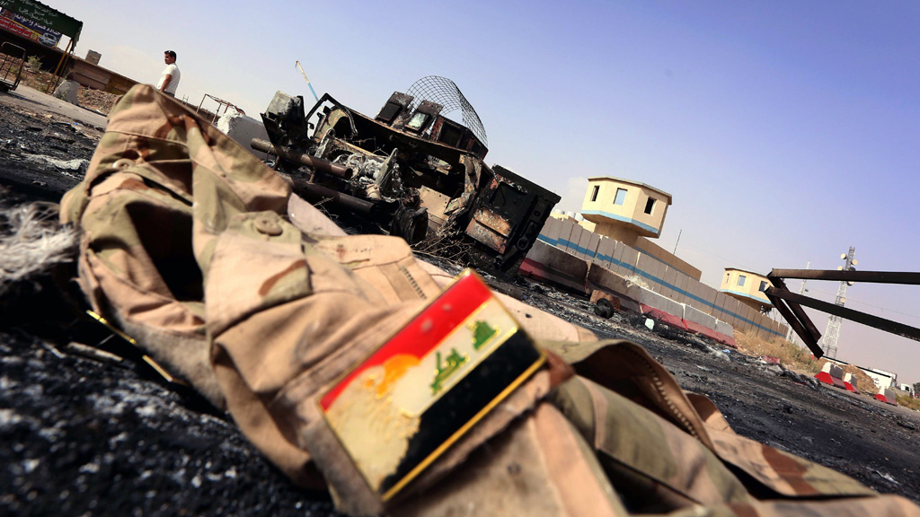 An abandoned uniform and jacket at a checkpoint east of Mosul, Iraq