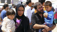 Iraqi family that has fled Mosul (picture: Reuters)