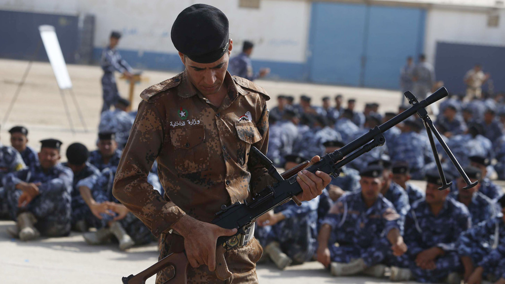 Newly-recruited Iraqi volunteers in police uniforms attend a training session at the Ibrahimiya police camp outside the central Iraqi Shiite city of Karbala (Getty)