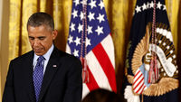 Barack Obama says the US is prepared to take 'targeted military action' in Iraq (R)