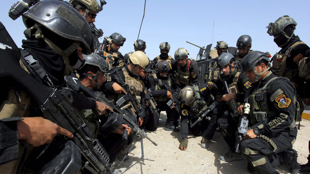 Iraqi forces battle for Tikrit