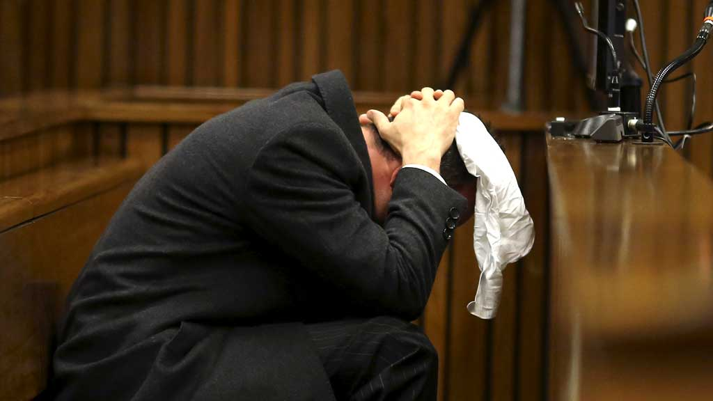 Pistorius vomits and retches into a bucket on hearing the details of the autopsy report read out to court on day six of the trial. (R)