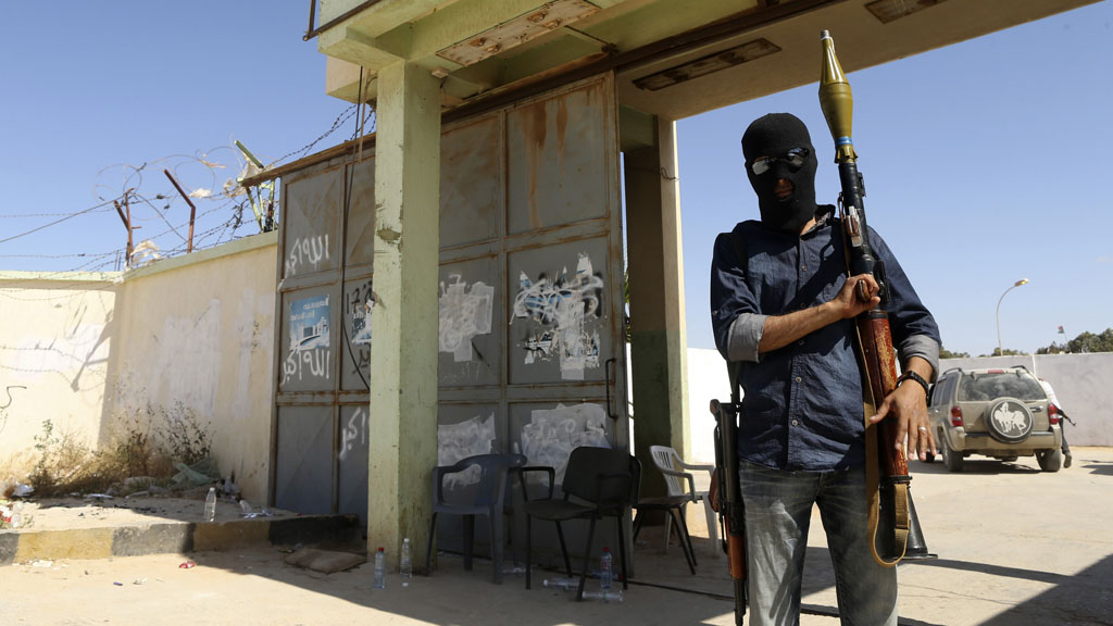 Militaman outside base in Libya (picture: Reuters)