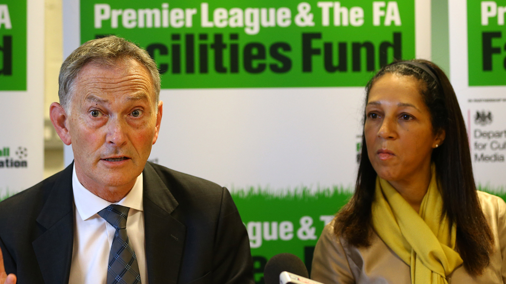 Premier League Chief Executive Richard Scudamore (L) and Minister of Sport and Equalities Helen Grant