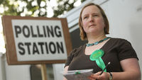Green Party supporter at polling station