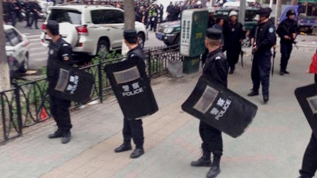 Police in Xinjiang following explosion