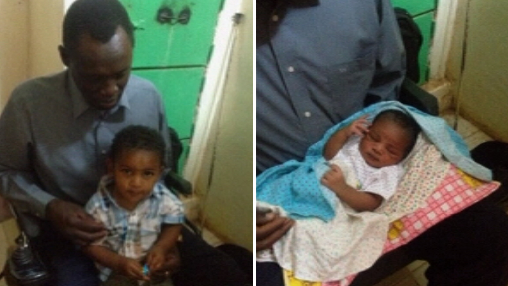 Meriam Ibrahim's husband Daniel Wani with the couple's young son and baby daughter