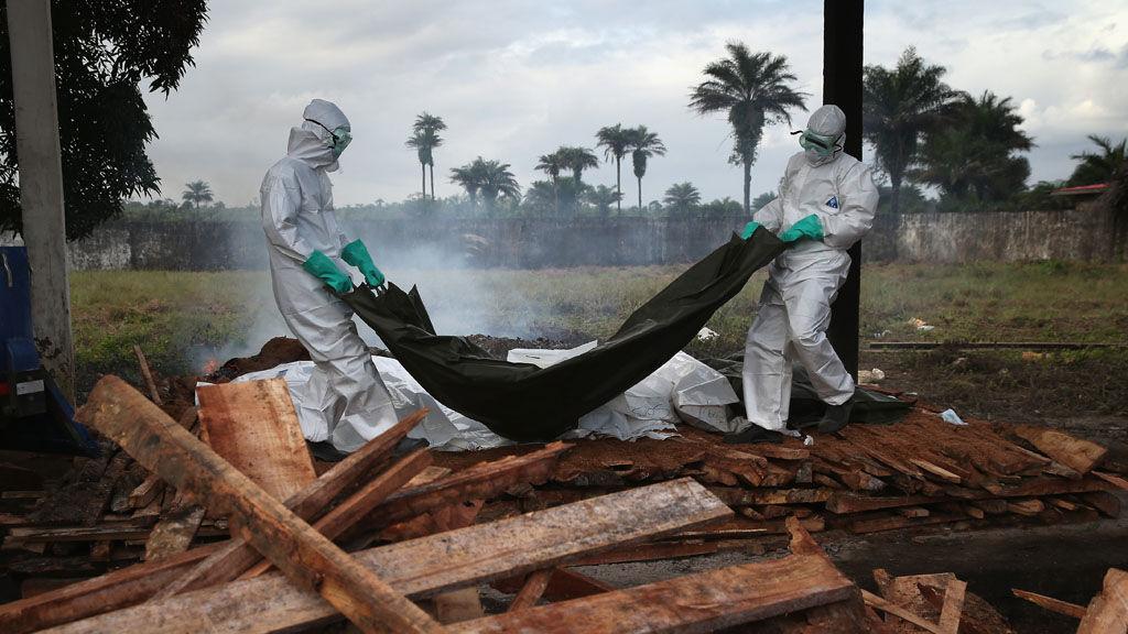 Volunteers burn bodies of Ebola victims in Sierra Leone (Getty)
