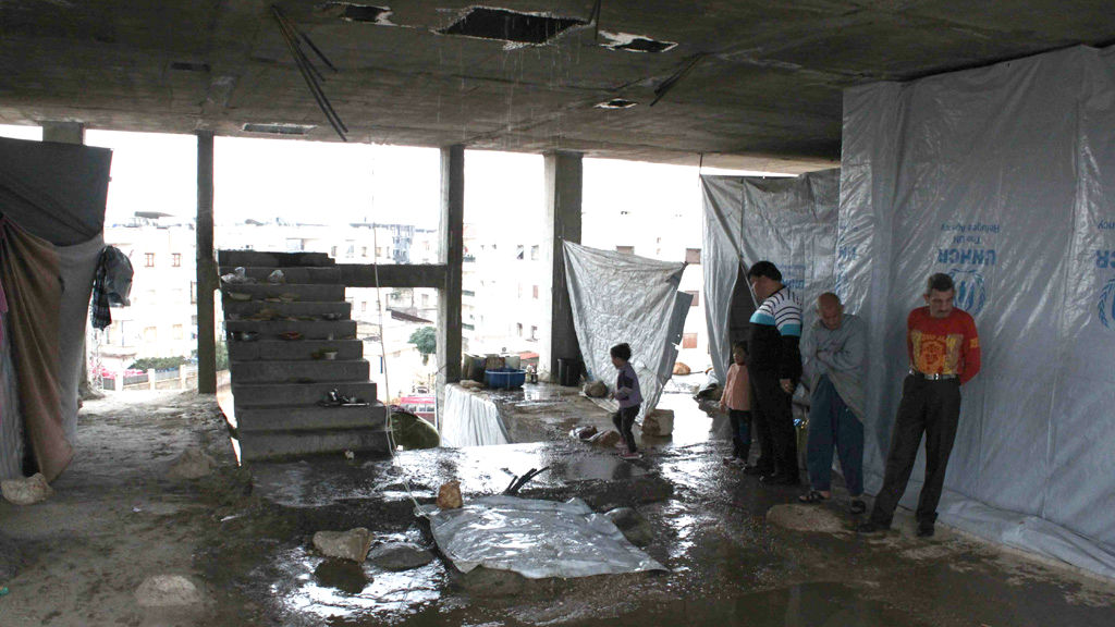 Families are living in partially built houses in Aleppo after being displaced by fighting
