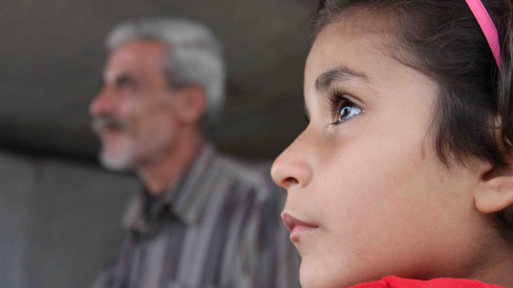 Seven-year-old Israa looks on as her father Mustafa Zakaria Naisa talks to Channel 4 News